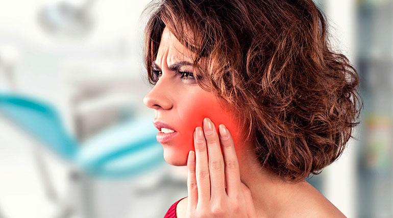 Болит зуб под коронкой: причины, лечение